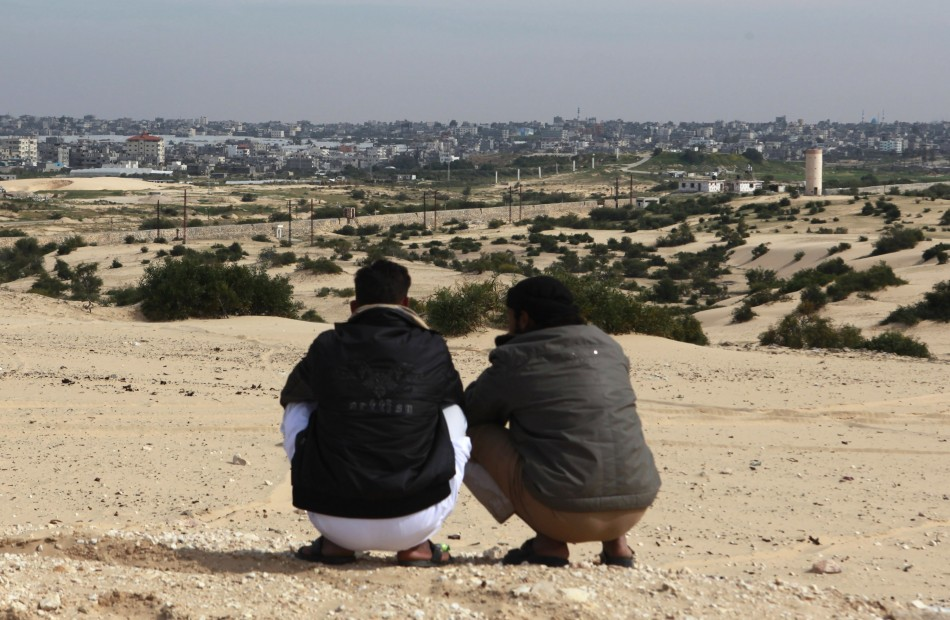 Bedouins squat over a hilly area overlooking Gaza, in Rafah city, north Sinai,