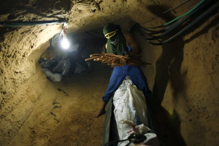 Palestinian smuggler prepares scrap metal to be exported to Egypt through a tunnel in Rafah, Reuters