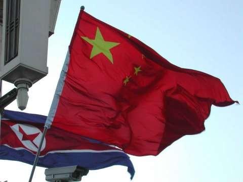Flags of China and North Korea