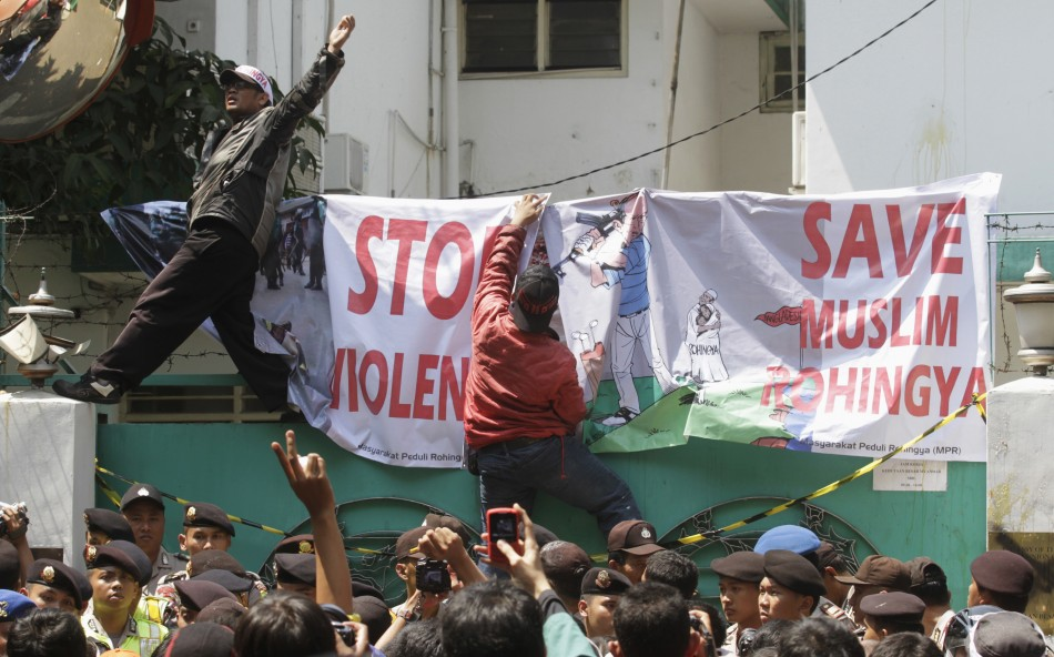 Muslim activists protest outside the Myanmar embassy in Jakarta