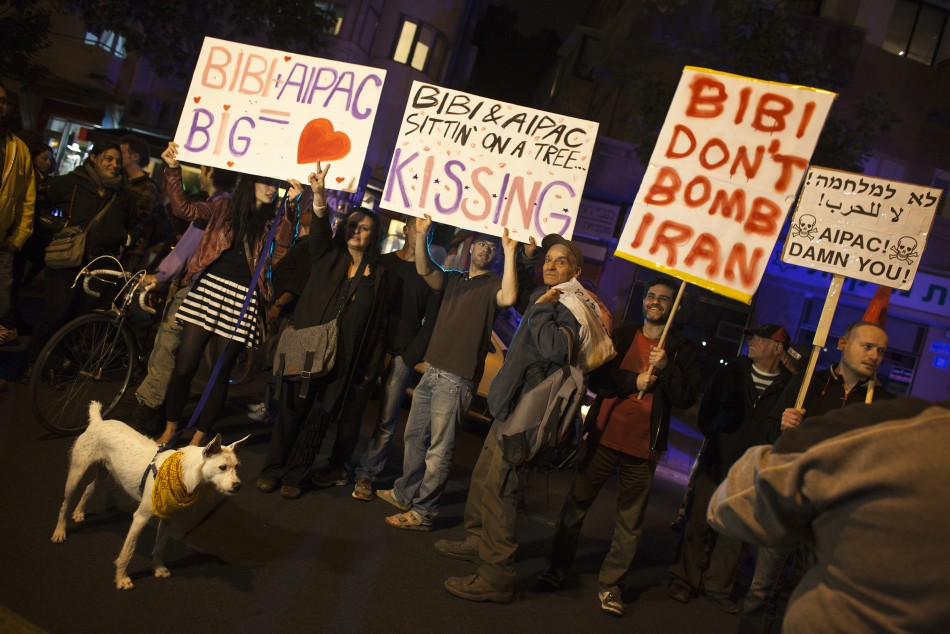 Israelis hold placards as they protest against a possible attack of Iran's nuclear facilities, in Tel Aviv, Reuters