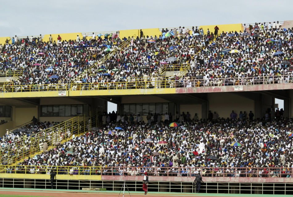 People take part in a rally for peace at the March 26 stadium in Bamako, Reuters