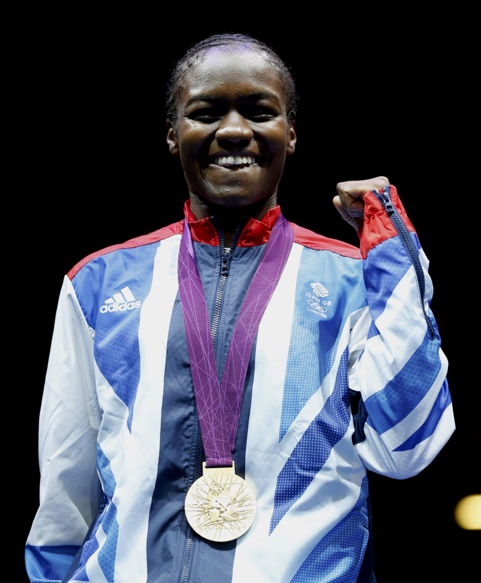 Britain's Nicola Adams poses with her gold medal after defeating China's Ren Cancan during their Women's Fly (51kg) gold medal boxing match at the London Olympic Games