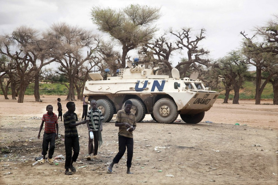 An UNAMID Armored Personnel Carrier from the Nepalese Special Forces patrols Kutum, Reuters