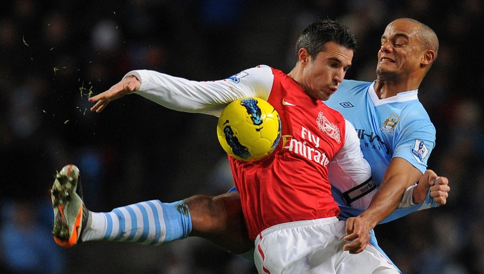 Robin van Persie and Vincent Kompany