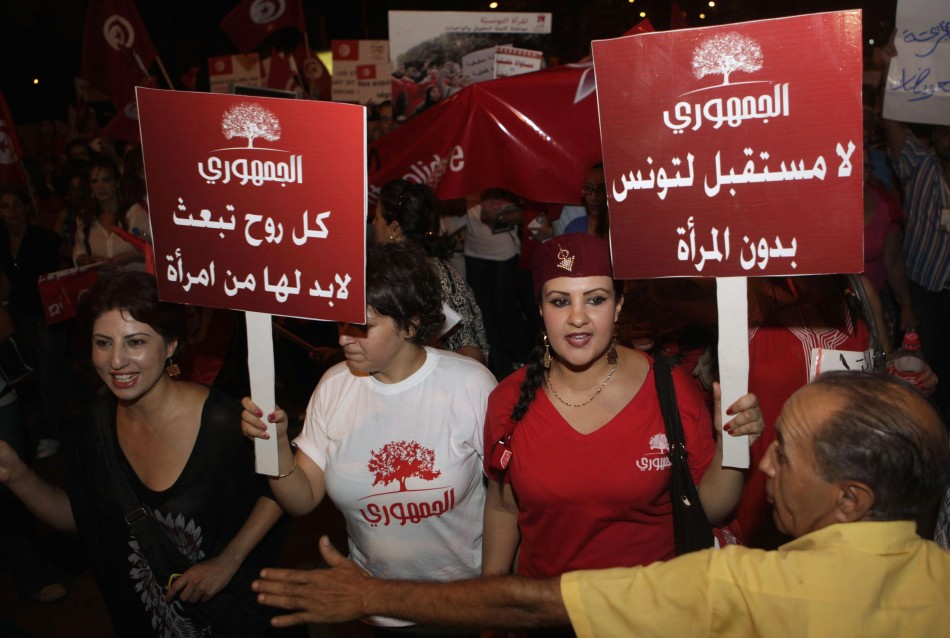 Women carry banners and shout slogans during a demonstration in Tunis, Reuters