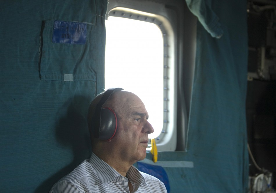Israeli Deputy Defence Minister Vilnai sits aboard helicopter on way to the Israeli-Lebanese border, Reuters