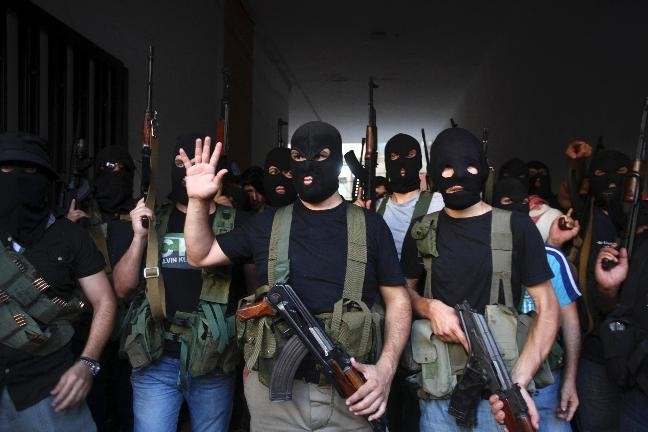 Shi'ite masked gunmen from the Meqdad clan, gather at the Meqdad family's association headquarters in the southern suburbs in Beirut