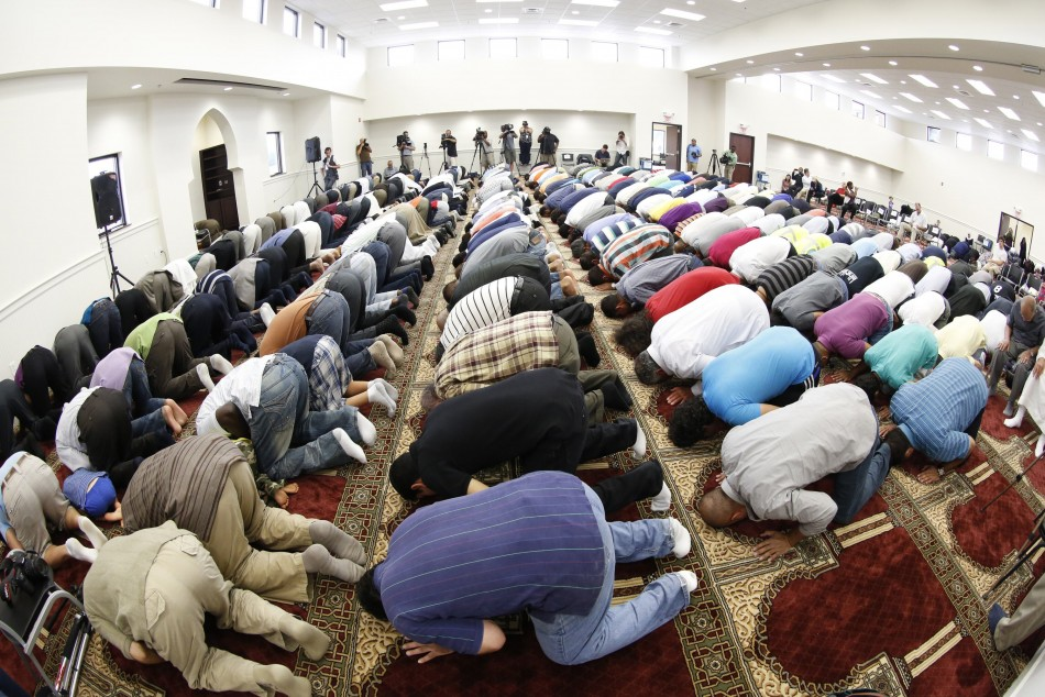 Musims pray in a mosque