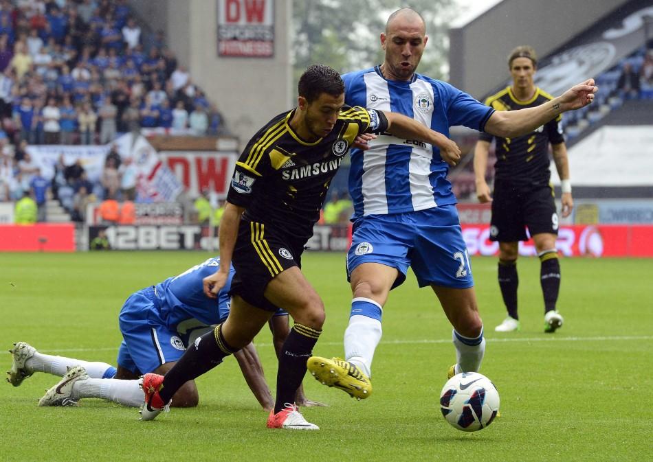 Wigan Athletic's Ivan Ramis Fouls Chelsea's Eden Hazard
