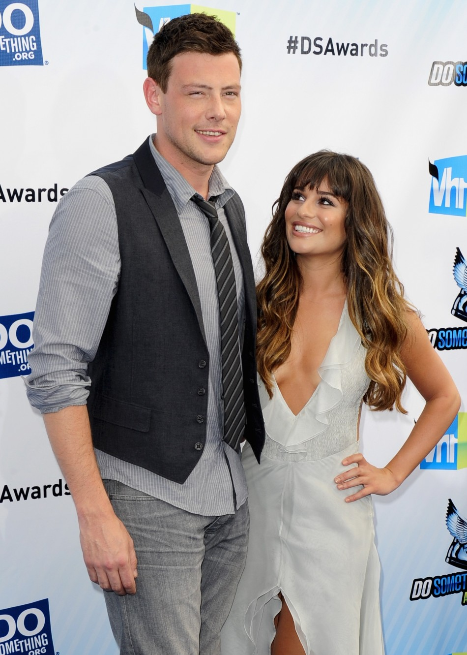 Actors Cory Monteith (L) and Lea Michele arrive at the