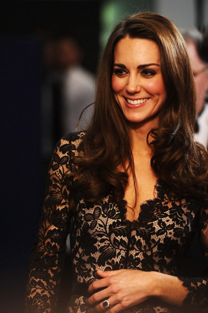 Catherine, Duchess of Cambridge attends the UK premiere of War Horse on the eve of her 30th birthday, at the Odeon Leicester Square cinema in London January 8, 2012 in London, England.  Kate sports her trademark glossy blow-dry hairdo. (Photo: REUTERS/Ian