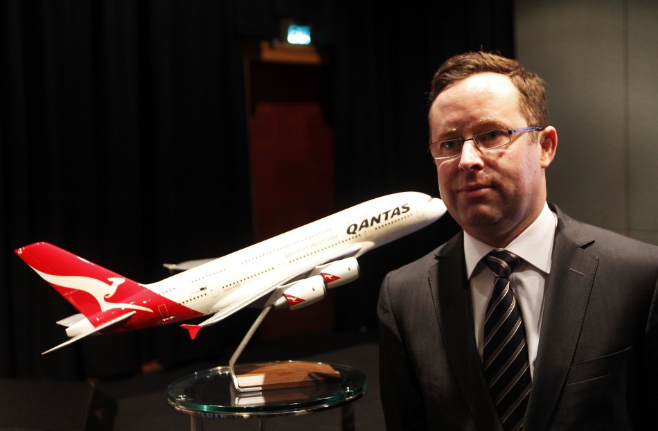 Qantas posts full-year loss