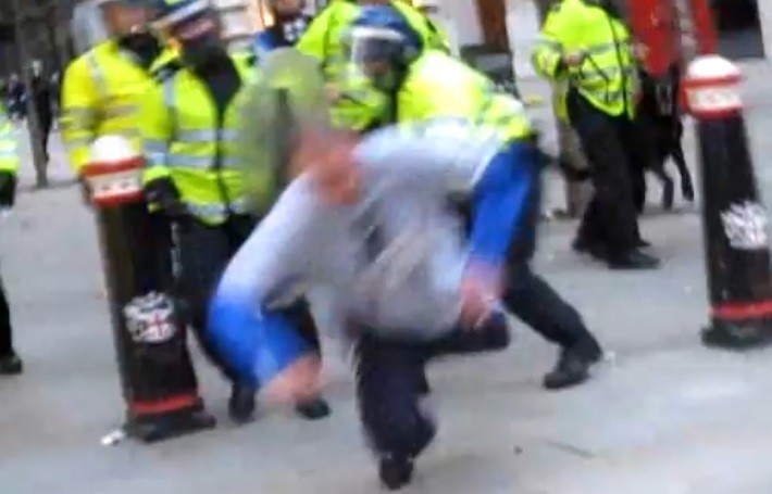 Ian Tomlinson flew to the ground after PC Simon Harwood struck him across the legs with a baton, video footage revealed at the G20 protests in central London (YouTube)