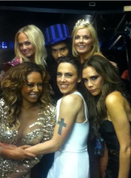 Russell Brand admitted he had a crush on Geri Halliwell after posing for this photo with the Spice Girls backstage at the Olympics.