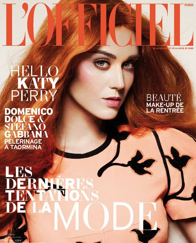 American pop star Katy Perry goes for orange hair on the cover of the September issue of L'Officiel Paris.