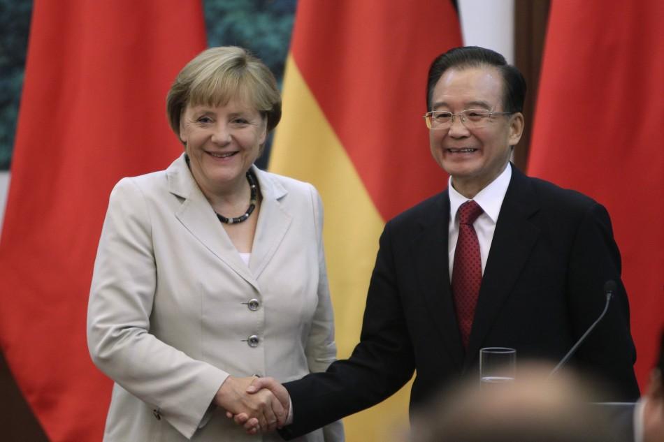 German Chancellor Angela Merkel shakes hands with China's Premier Wen Jiabao in Beijing