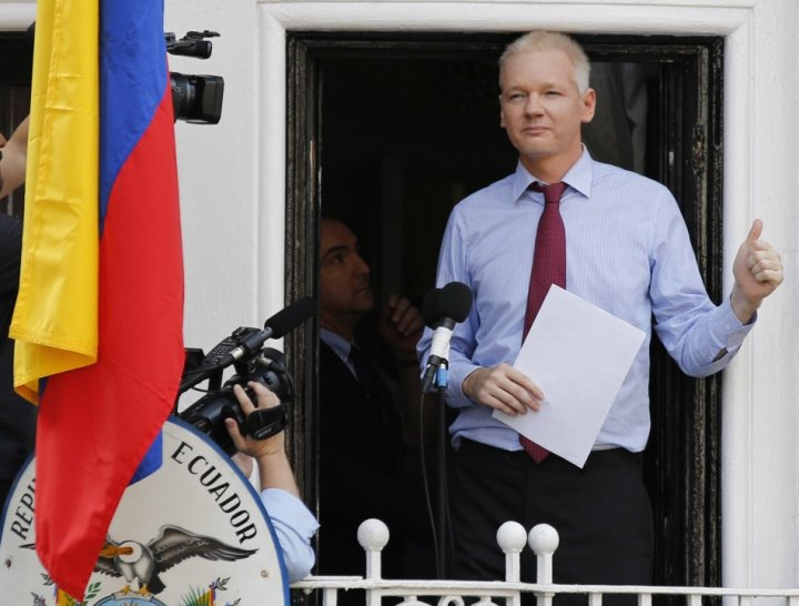 Wikileaks founder Julian Assange gestures as he appears to speak from the balcony of Ecuador's embassy in London