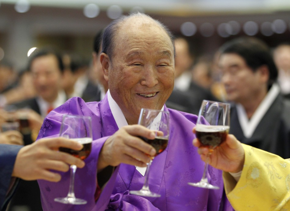 Evangelist Reverend Moon drinks a toast with his family members during his birthday party in Gapyeong