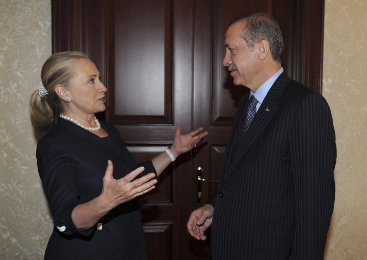 Turkey's Prime Minister Erdogan talks with U.S. Secretary of State Clinton before their meeting