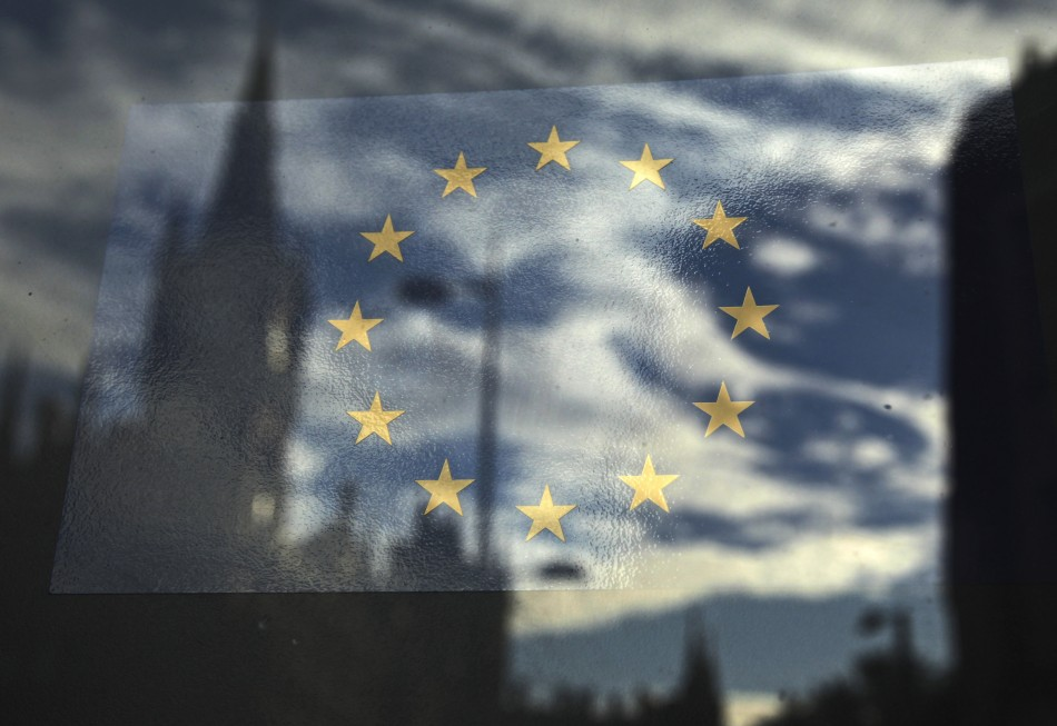 The European Union flag is pictured in a window reflecting a street in London (Photo: Reuters)