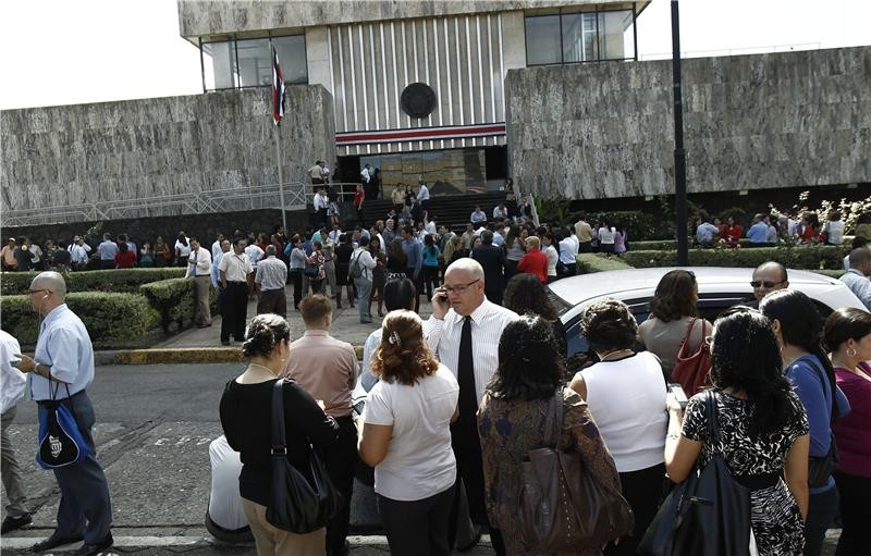 People gather in front of the Supreme Court, after being evacuated from their buildings following an earthquake in San Jose (Reuters)