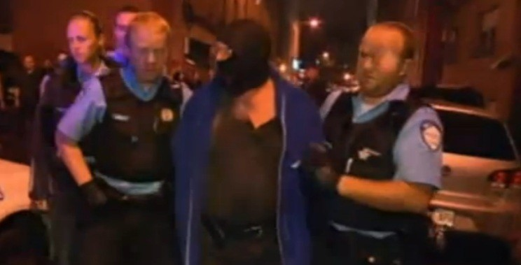 TV pictures showed the alleged gunman being arrested (BBC)