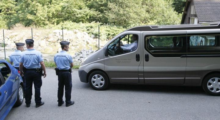 French gendarmes escort hearses leaving La Combe d'Ire raoad in Chevaline