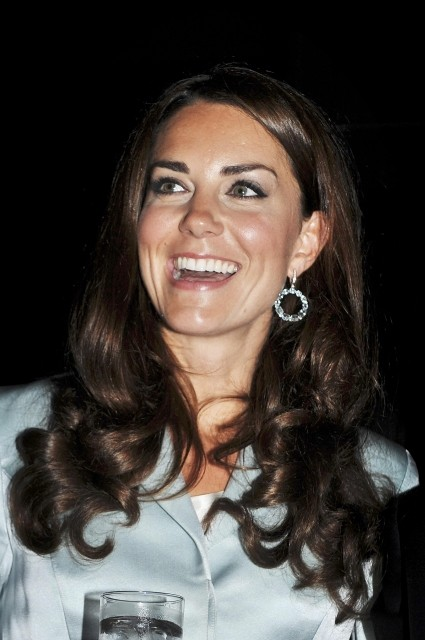 Kate Middleton smiles before the opening ceremony of the London 2012 Olympic Games at the Olympic Stadium July 27, 2012. The Duchess of Cambridge has been credited for letting London win the top global fashion capital for consecutive two years. REUTERS/Jo