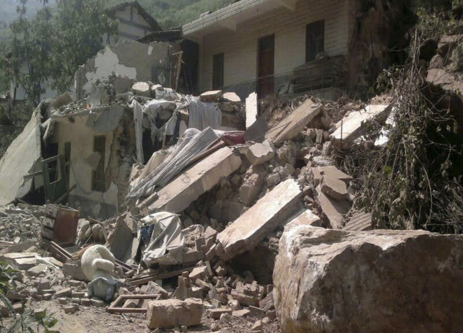 A collapsed house is seen after two earthquakes in Zhaotong, Yunnan province (Reuters)