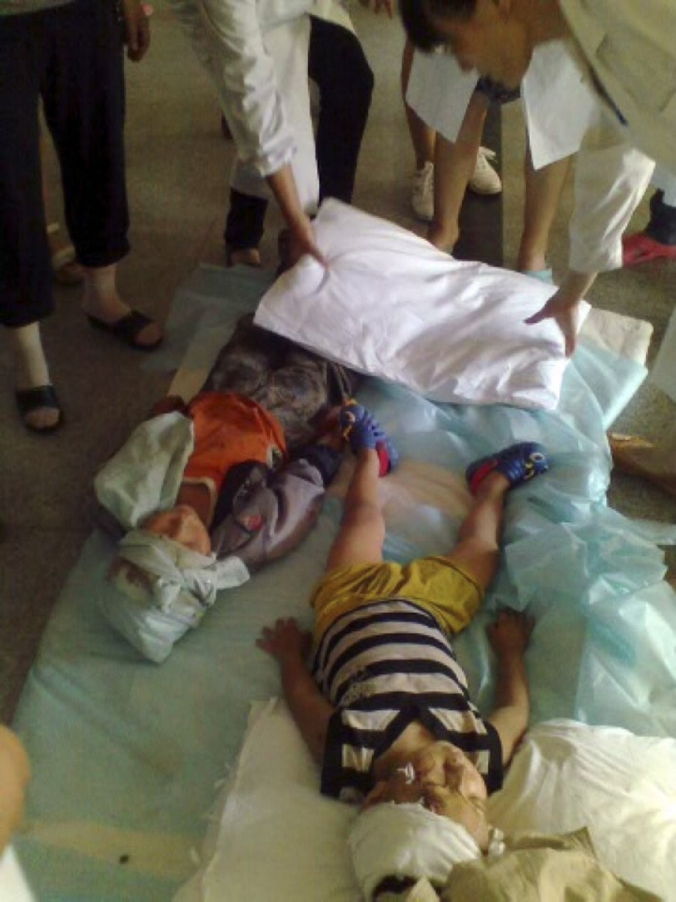 Injured children lie on the floor at a hospital after two earthquakes hit Zhaotong (Reuters)