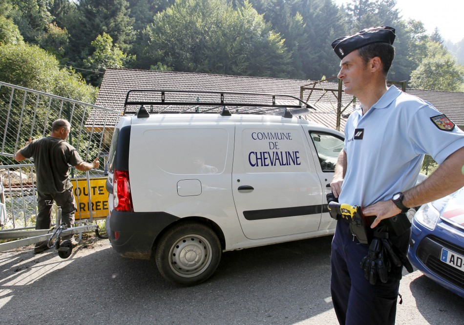 French gendarmes block access to a road to La Combe d'Ire in Chevaline