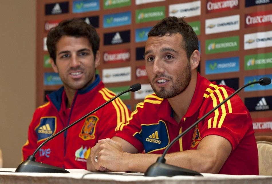 Cesc Fabregas and Santi Cazorla (R)