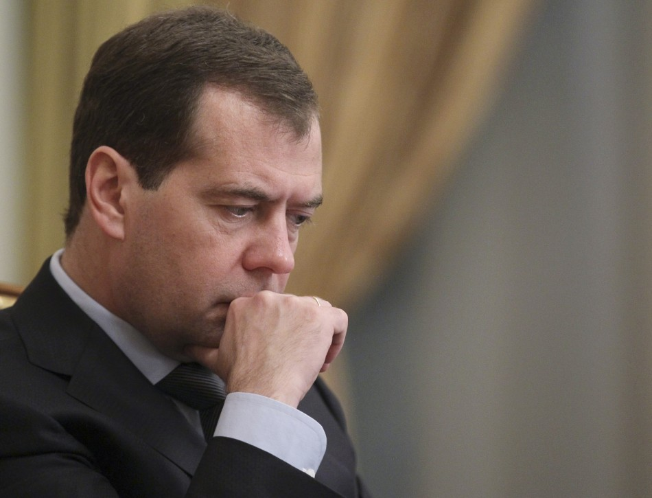 Russia's PM Medvedev looks on during a government session at the Russian White House in Moscow