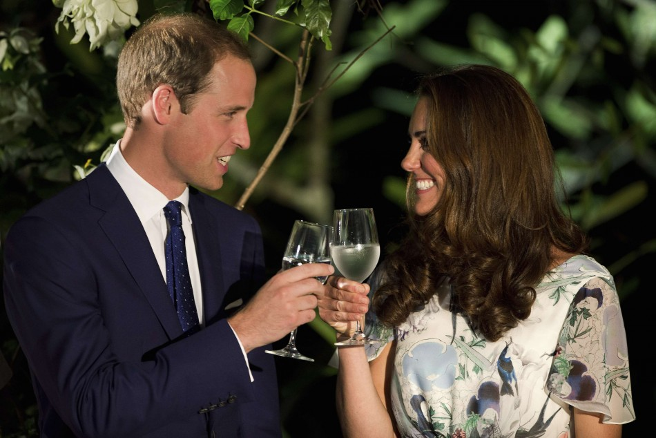 Britain's Prince William and his wife Catherine, the Duchess of Cambridge, make a toast in the honour of Queen Elisabeth's Diamond Jubilee at a British Gala reception at the Eden Hall in Singapore