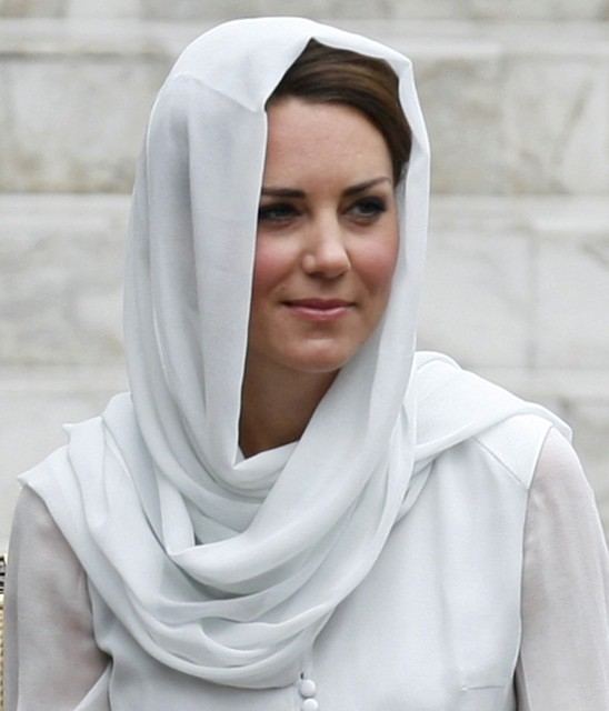 Catherine, Britain's Duchess of Cambridge, wears a shawl around her head as she sits on a chair after removing her shoes before entering As-Syakirin Mosque at KLCC in Kuala Lumpur, September 14, 2012. (Photo: REUTERS)