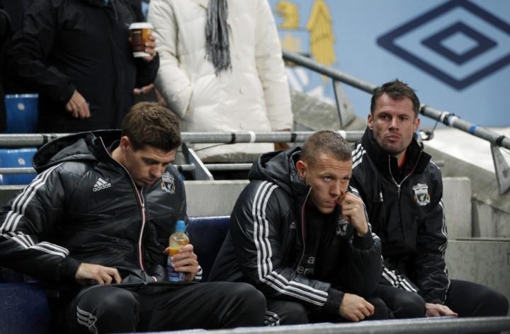 Steven Gerrard (L), Craig Bellamy and Jamie Carragher (R)