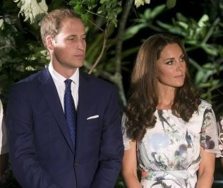 Prince William and his wife Catherine, the Duchess of Cambridge, listen to a speech at a British Gala reception at the Eden Hall in Singapore September 12, 2012. The royal couple will file a criminal law suit against French magazine Closer for breaching t