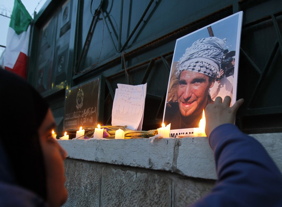 A Jordanian woman lights candles during a protest against the killing of Italian activist Vittorio Arrigoni in Amman