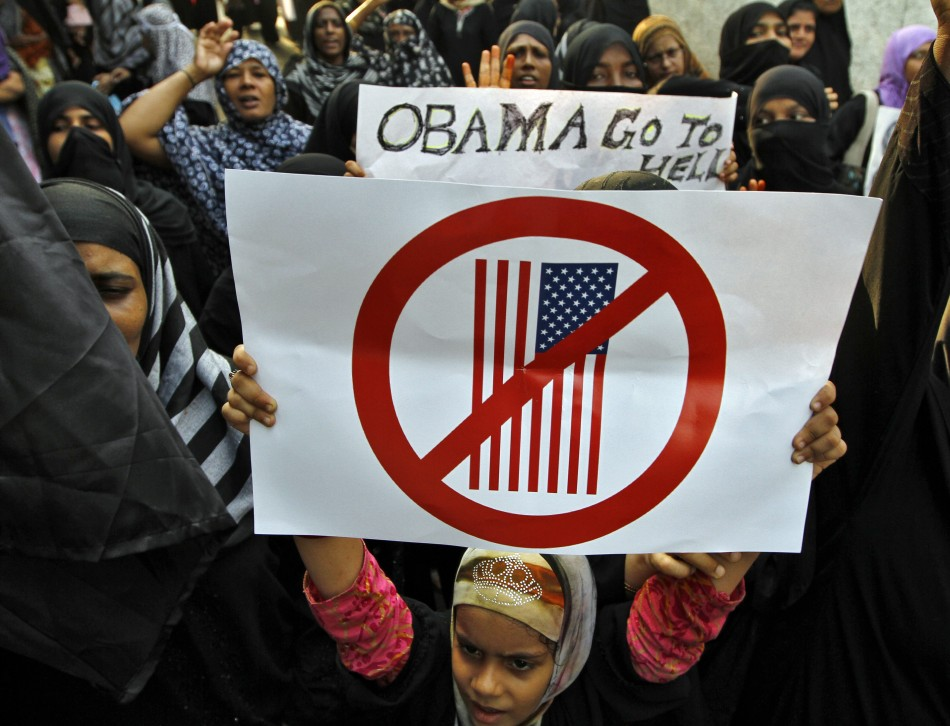 Muslim demonstrators hold placards during an anti-U.S. protest against a film