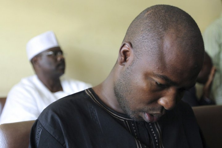 Suspected member of Islamic sect Boko Haram, Konduga sits inside Wuse Magistrate court next to senator Ndume during his trial (Reuters)