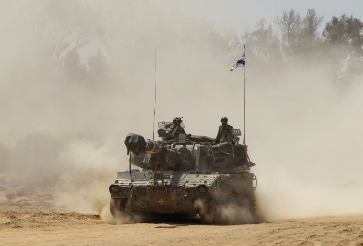 An Israeli mobile artillery unit travels after a live-fire display during a conference held by the Israeli Defence Force