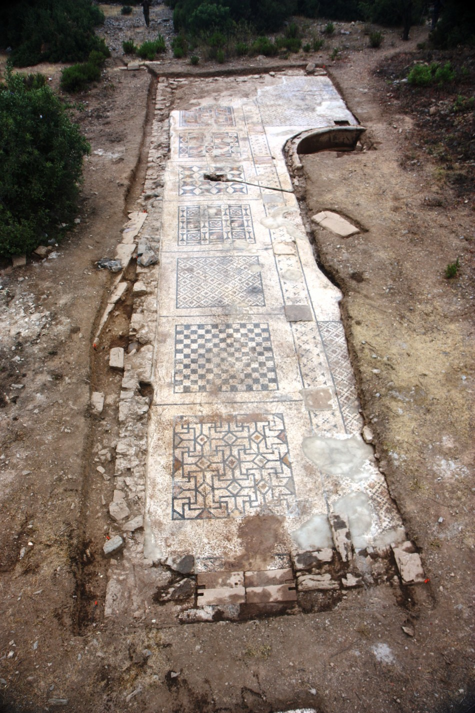 An overhead perspective of the roughly 40 percent of the mosaic uncovered so far. Researchers expect its total area to be about 1,600 square feet when fully unearthed next summer. (Photo: University of Nebraska-Lincoln)