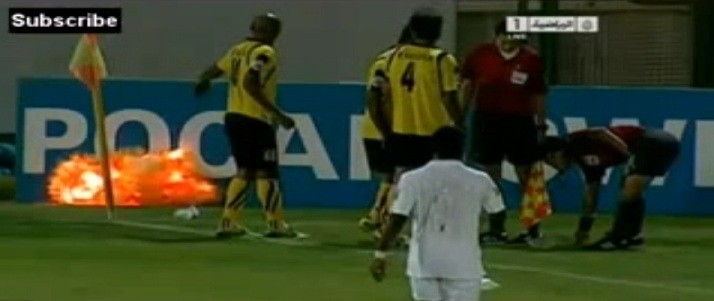 Sepahan midfielder Adel Kolahkaj narrowly avoids serious injury after throwing the explosive off the pitch. (YouTube)