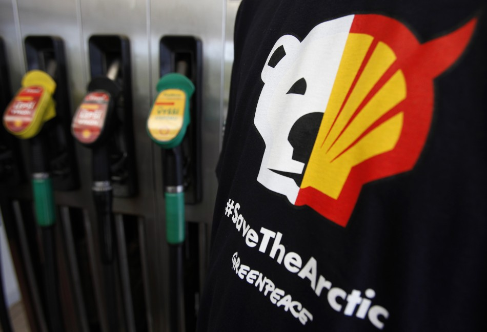 A T-shirt of a Greenpeace environmental activist is seen next to gas pumps at a Shell gas station in Prague (Reuters)
