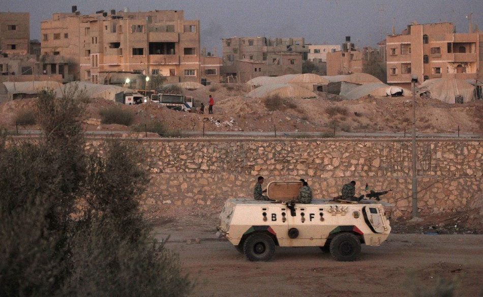 An armoured vehicle patrols the border with Gaza Strip