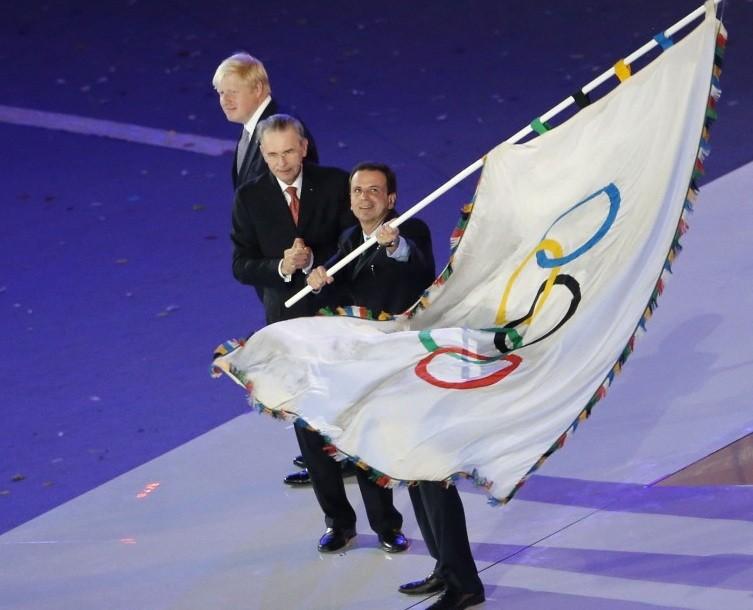 Rio de Janeiro Mayor Eduardo da Costa Paes waves Olympic flag at London Olympics' closing ceremony