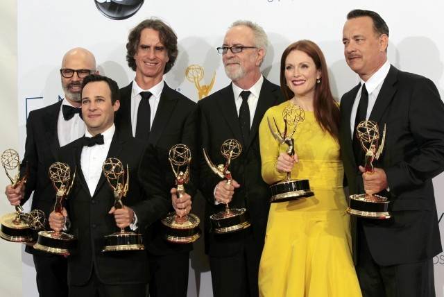 Steven Shareshian, Jay Roach, Danny Strong, Gary Goetzman, Julianne Moore and Tom Hanks hold their Emmy awards for outstanding miniseries or movie for