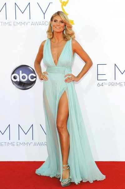 Model Heidi Klum, host of the reality competition series Project Runway, arrives at the 64th Primetime Emmy Awards in Los Angeles