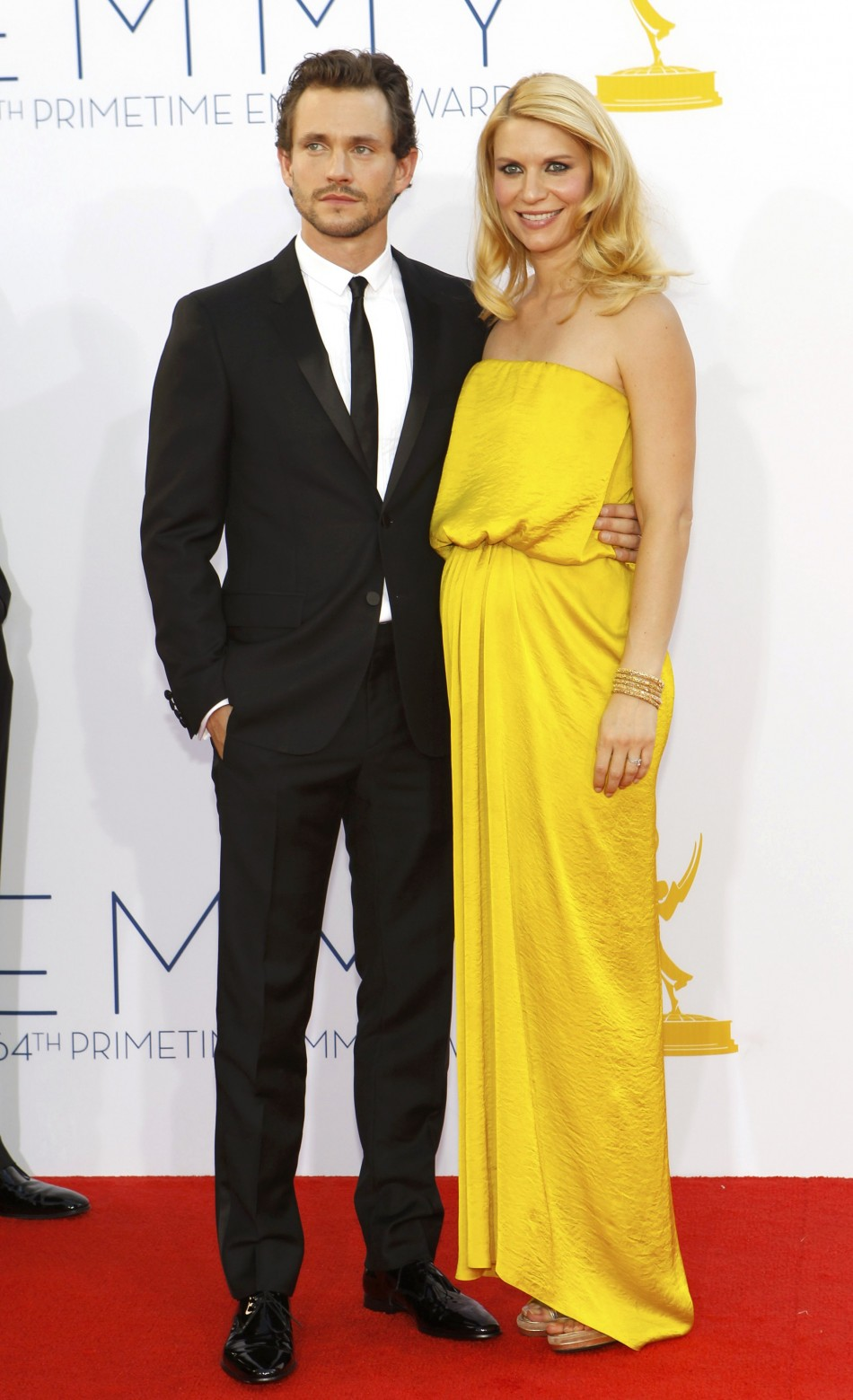 Actress Claire Danes of the drama series Homeland and her husband actor Hugh Dancey arrive at the 64th Primetime Emmy Awards in Los Angeles